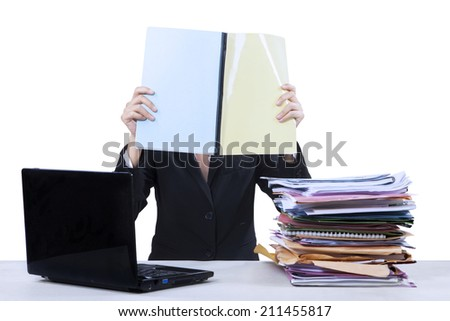 Portrait of businesswoman reads documents at office - stock photo