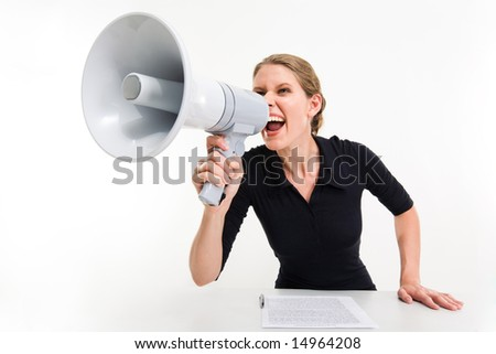 Portrait of businesswoman sitting at the table and speaking through megaphone - stock photo