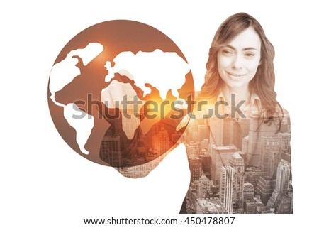 Portrait of businesswoman touching invisible screen against earth - stock photo