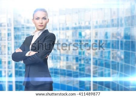 Portrait of businesswoman with hands crossed, on blue background. Concept of leadership and success - stock photo