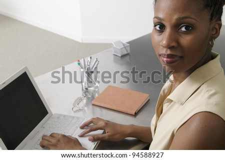 Portrait of businesswoman with laptop - stock photo