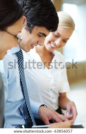 Portrait of busy companions discussing new working plan at meeting - stock photo