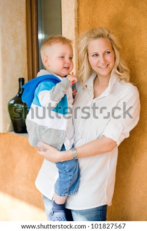 Portrait of casually dressed cute son and mother. - stock photo