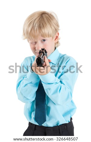 Portrait of Caucasian blond boy aiming with black gun in hands, isolated on white background - stock photo
