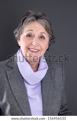 Portrait of caucasian elderly woman isolated over grey background.  - stock photo