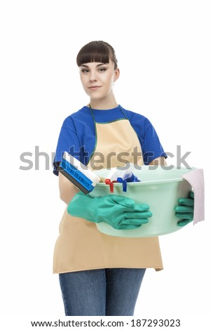 Portrait of Caucasian Housewife Holding Cleaning Gear. isolated On White. Vertical Image - stock photo
