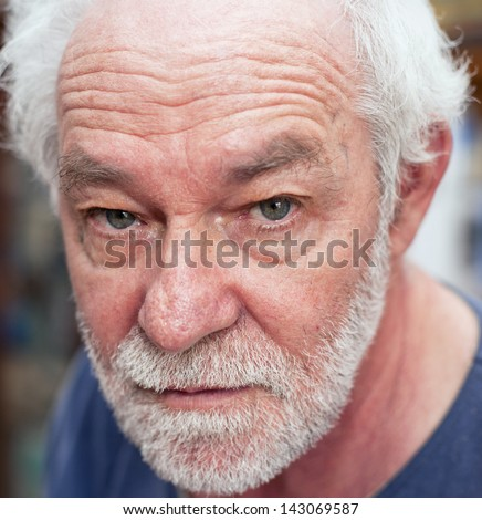 Portrait of caucasian man. Blue eyes, white beard, neutral expression. - stock photo