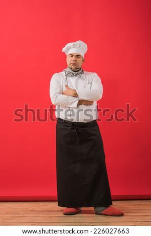 Portrait of caucasian man with chef uniform - stock photo