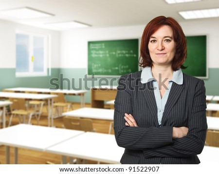 portrait of caucasian teacher and classroom background - stock photo