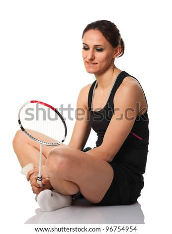 portrait of caucasian woman with badminton racket - stock photo