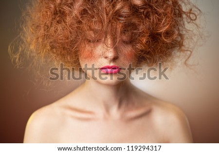 Portrait of  caucasian young woman with beautiful red  curly hair - stock photo