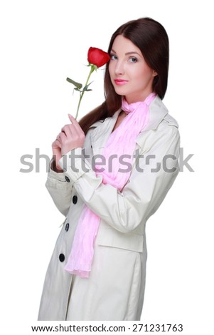Portrait of charming brunette with long hair holding red rose - stock photo