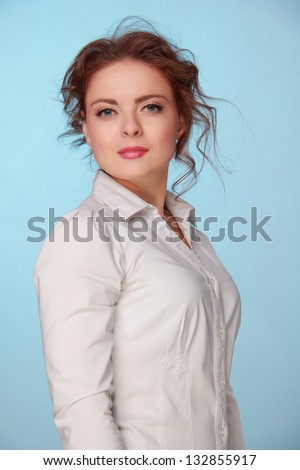 Portrait of charming girl with beautiful hair in a white blouse - stock photo