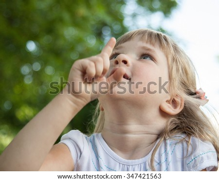 Portrait of charming little girl in a summer park - stock photo