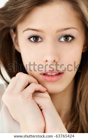 Portrait of charming woman on grey background. - stock photo