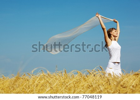 Portrait of charming young girl raising her hands with fabric - stock photo