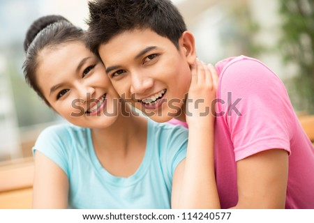 Portrait of charming young people looking at camera with an affectionate smile - stock photo