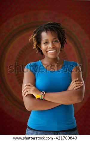 Portrait of cheerful African-American woman looking at camera - stock photo