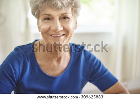Portrait of cheerful and attractive senior woman - stock photo