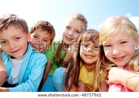 Portrait of cheerful boy and girl looking at camera - stock photo