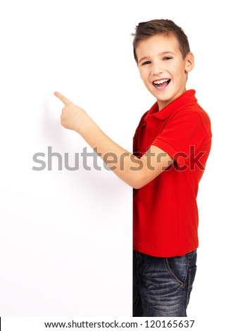 Portrait of  cheerful boy pointing on white banner - isolated on white background - stock photo