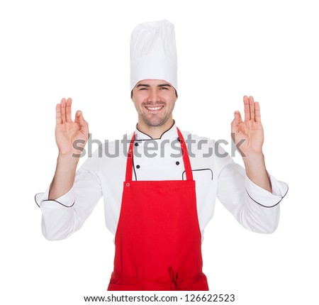 Portrait of cheerful chef in uniform. Isolated on white - stock photo