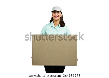 Portrait of cheerful delivery woman with box against white background - stock photo