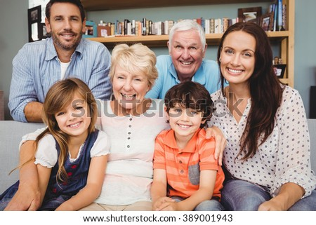 Portrait of cheerful family with grandparents at home - stock photo