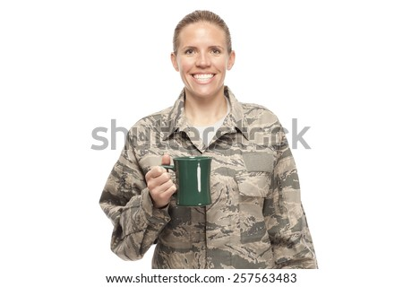 Portrait of cheerful female airman with coffee cup against white background - stock photo