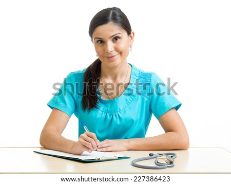 Portrait of cheerful female physician with clipboard - stock photo