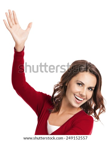 Portrait of cheerful gesturing young woman, showing something, isolated over white background - stock photo