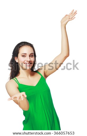 Portrait of cheerful gesturing young woman, showing something, over white background - stock photo