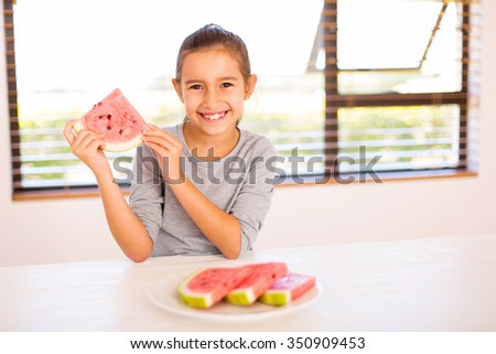 portrait of cheerful girl holding a slice of watermelon - stock photo