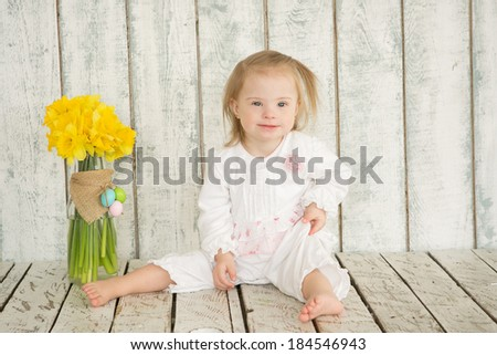 Portrait of cheerful girl with Down syndrome - stock photo