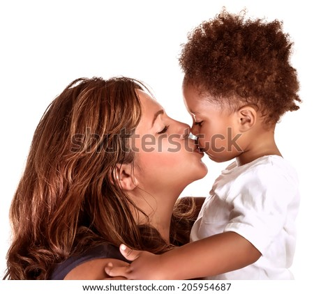 Portrait of cheerful mother kissing baby, studio shot, happy motherhood, lovely African family, happiness and love concept - stock photo