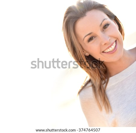Portrait of cheerful natural woman with long hair  - stock photo