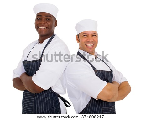 portrait of cheerful restaurant chefs arms crossed - stock photo