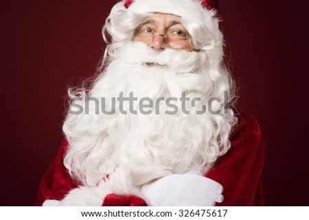 Portrait of cheerful santa claus in the studio - stock photo