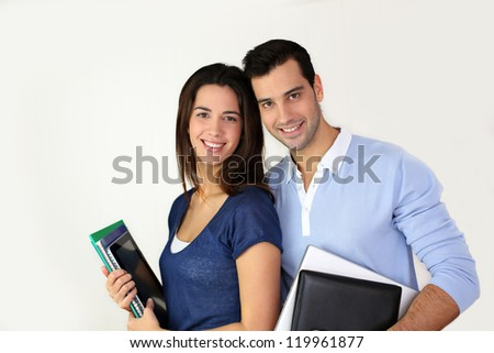 Portrait of cheerful students smiling at camera - stock photo