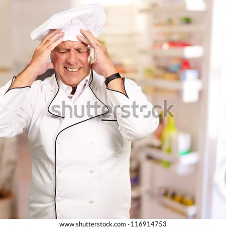 Portrait Of Chef With Painfully Head, Indoor - stock photo