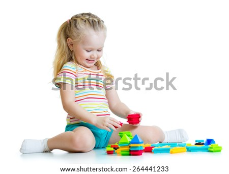 Portrait of child girl with toy blocks isolated - stock photo
