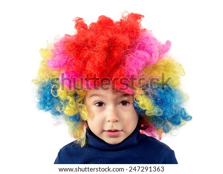 Portrait of child with clown wig isolated on white - stock photo