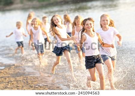 Portrait of children on the beach in summer - stock photo