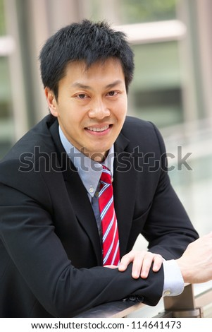Portrait Of Chinese Businessman Outside Office - stock photo