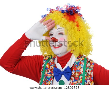 Portrait of clown gesturing salute with hand - stock photo