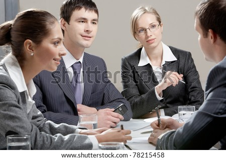 Portrait of colleagues planning their work in office - stock photo