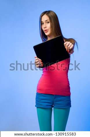 Portrait of colorful emoticon girl holding up tablet computer. - stock photo