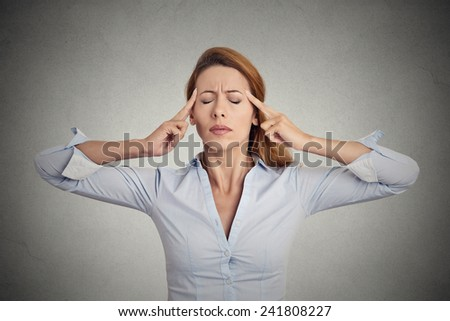 Portrait of concentrating woman isolated on grey wall background. - stock photo