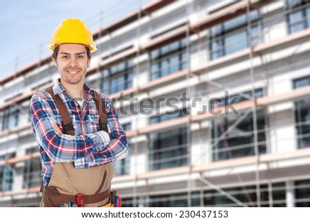 Portrait of confident architect with arms crossed standing against building - stock photo