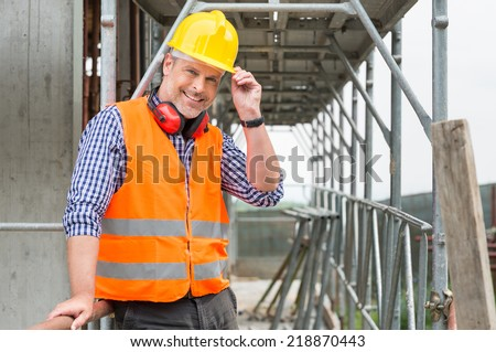 Portrait Of Confident Bricklayer At Construction Site - stock photo
